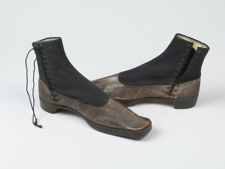 1851 Pair of men's boots with black cloth uppers and a brown welt. Everett & Co., England. Presumably associated with the 1851 Great Exhibition. V&A Museum.