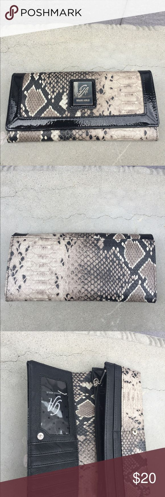 Grace Adele Contrast Python Wallet Grace Adele Wallet. Lots of card slots & room. Perfect wallet style. EUC. Needs a new loving home. Bundle up & save 15% off or make me an offer! Happy Poshing! Grace Adele Bags Wallets