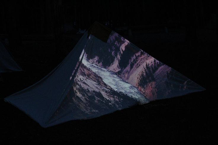 image showing a tent in Yellowstone National Park with projection of Artist's…