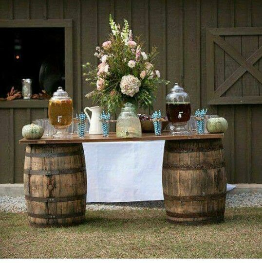 Whiskey barrels are all the rage at rustic, country, western, wine, whiskey, and warehouse theme weddings. These universal wedding decorations can be used as cocktail tables or set up as an indoor/outdoor bar or drink station. They can also be used to create rustic candy or popcorn buffets.