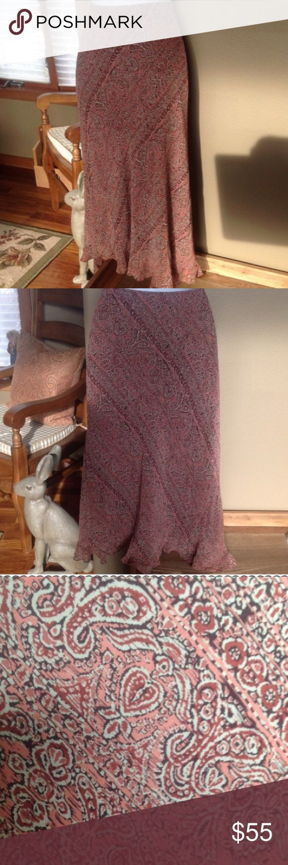 "🍃💕INC Paisley Boho Print 100% Silk Skirt Absolutely beautiful fully lined 100% silk midi skirt in gorgeous Boho paisley print. Features hidden side zip with hook & eye closure, bottom subtle flounce ruffle hem. Waist to hem measures approximately 30"", waist also 30"". This is a petite size 8, I wear a size 4 normally and this I have worn it as a low rise hipster so it sits a few inches above my ankles at 5'10"" to give you the idea. Gently worn a couple of times & in pristine condition…"