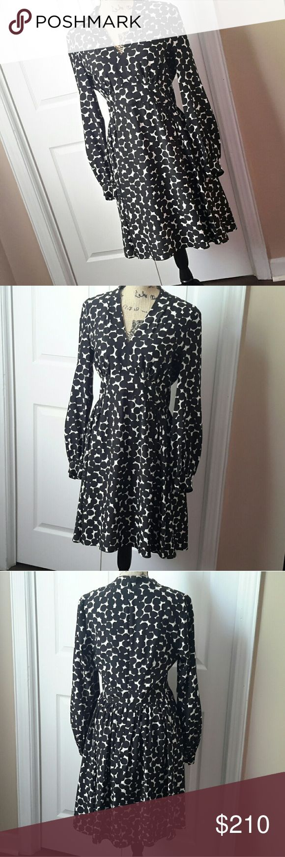 """Kate Spade Blot Dot V-neck Dress - NWT Dress to impress!! Gorgeous & flattering details: deep v-neckline, elegant polka-dotted print, this silk dress is great for any occasion!! Color: French Cream & black 100% silk (lining is 100% Polyester), long sleeves, v-neck  Fit and flare - 37"""" long from highest shoulder point Center back zipper with hook and eye above Size 8 measurements (from Katespade.com):  Bust: 36.5""""; Natural waist: 29""""; Hip: 39"""" New with tag kate spade Dresses"""