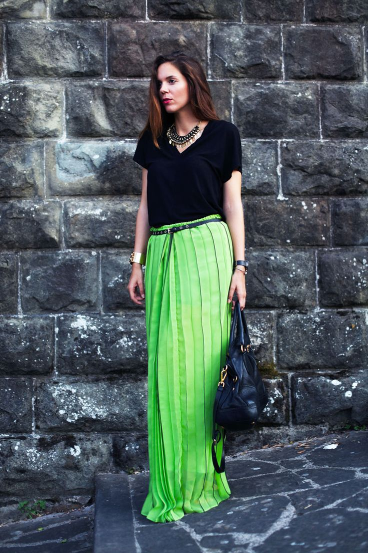 A long pleated skirt in a bright colour is perfect for summer