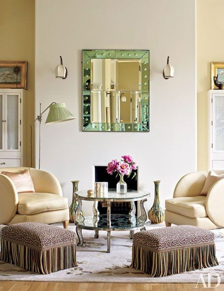 Midler's dressing room is graced with an Art Deco mirror and Paris flea-market chairs; the stools are covered in a Brunschwig & Fils print
