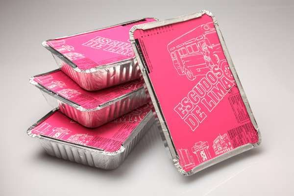 Escudos de Lima T-shirts are wrapped in aluminum foil boxes with paper lids that make them look more like your takeaway dinner. If you want to customize a good-looking t-shirt packaging, visit www.unifiedmanufacturing.com.