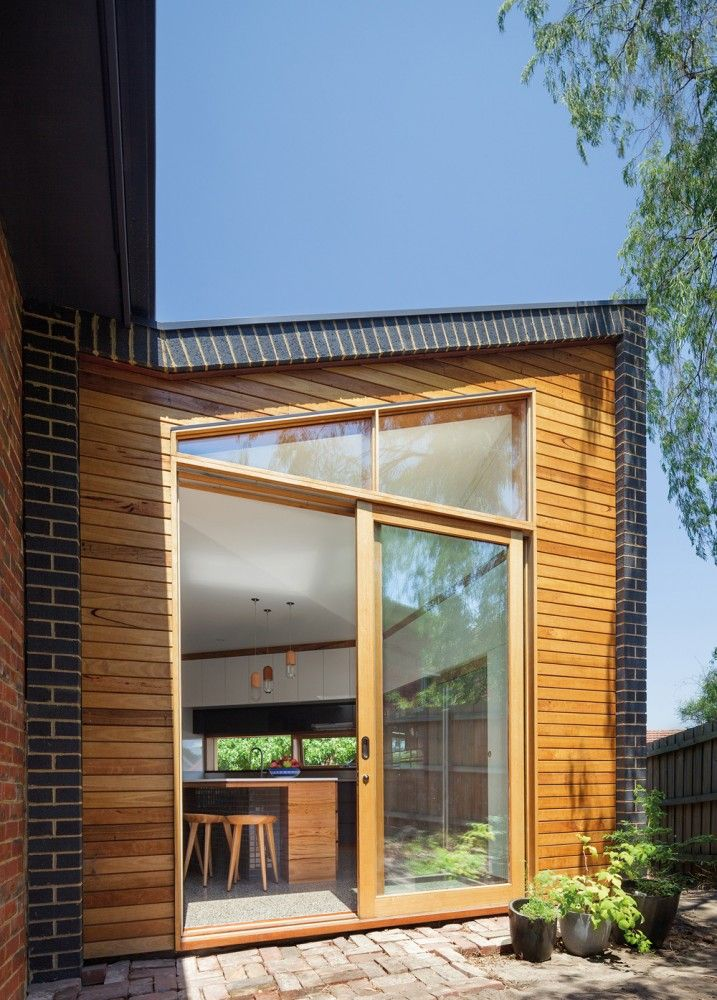Forever House / WoodWoodWard Architecture. North face of our little extension nugget is neatly tucked under the eave of existing house. cute.