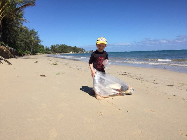 Garbage Pickup on Oahu Shores. Today we are helping get a bag of trash off thebeach. While it is not even a dent in the debris, it is a lesson for the kids