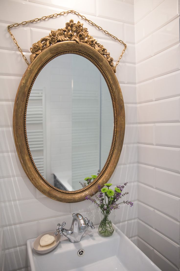 Vintage style bathroom with beautiful golden mirror