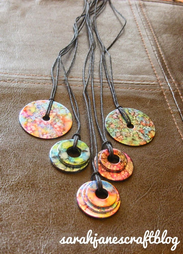alcohol washer necklaces - great instructions and pics showing each step.  use mod podge at end to seal and tie with cording.  $7-$10 for pack of 3 inks, use 40% michaels coupon for additional savings