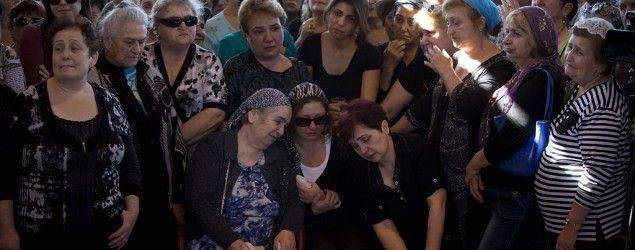 Relatives and friends mourn during the funeral of an Israeli man killed during a spate of recent knife attacks. (AP)