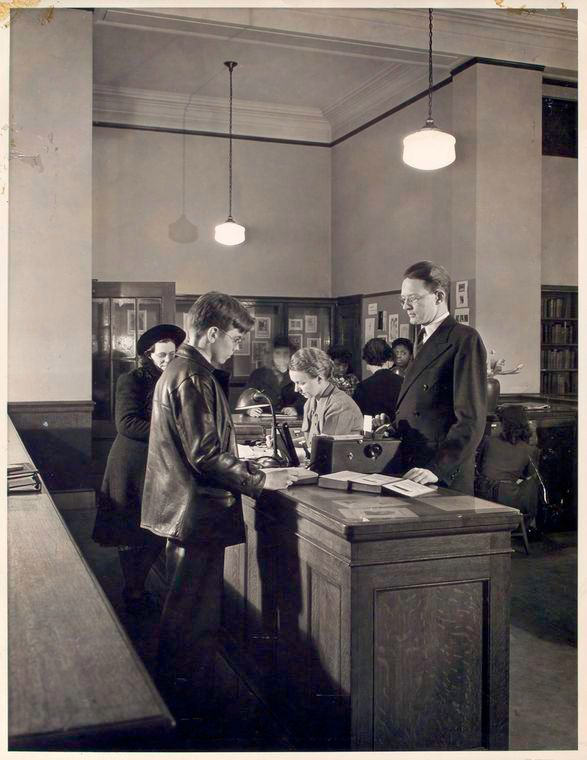Librarian At Desk With Patron Photo by Smith Collection/Gado on Getty Images
