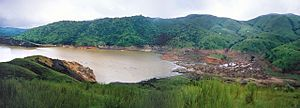 Lake Nyos. Today, the lake also poses a threat because its natural wall is weakening. A geological tremor could cause this natural levée to give way, allowing water to rush into downstream villages all the way into Nigeria and allowing much carbon dioxide to escape.