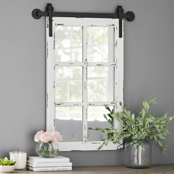 The style of a windowpane meets the function of a mirror. Adding farmhouse style to your entryway has never been easier.