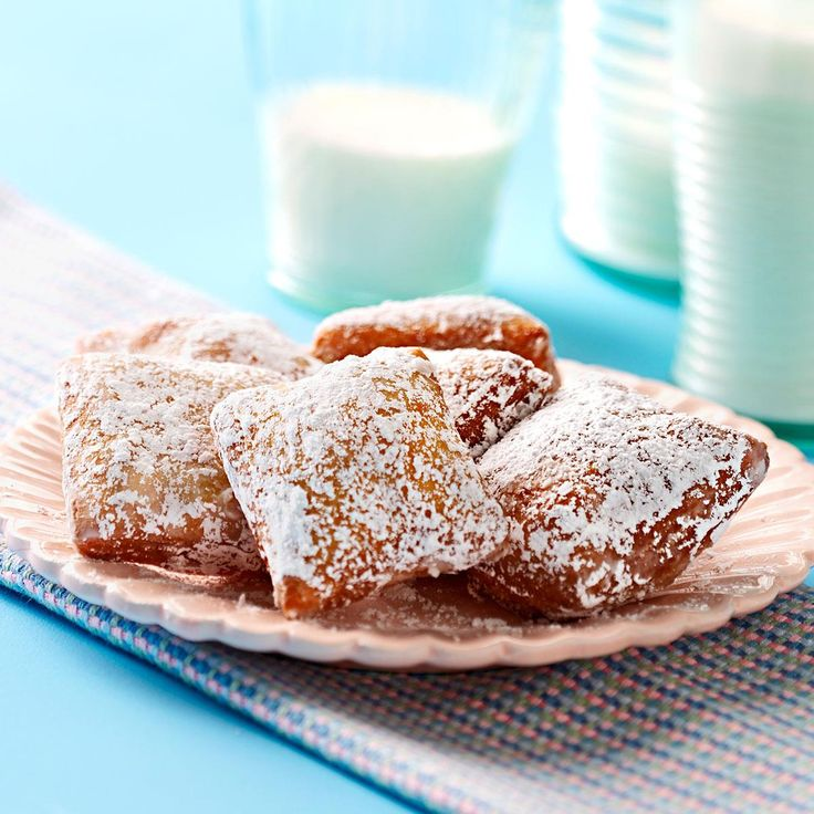 New Orleans Beignets Recipe -These sweet French doughnuts are square instead of round and have no hole in the middle. They're a traditional part of breakfast in New Orleans. —Beth Dawson, Jackson, Louisiana