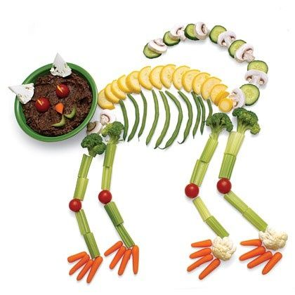 Feelin' up for a bit of a challenge? Creepy Skeleton Cat is sure to impress. Use carrots, cucumber, mushrooms, tomatoes, lemons, cauliflower & broccoli to imitate the shape. A bowl of veggie dip or low-fat chocolate pudding makes a great head! #diettogo #healthyhalloween