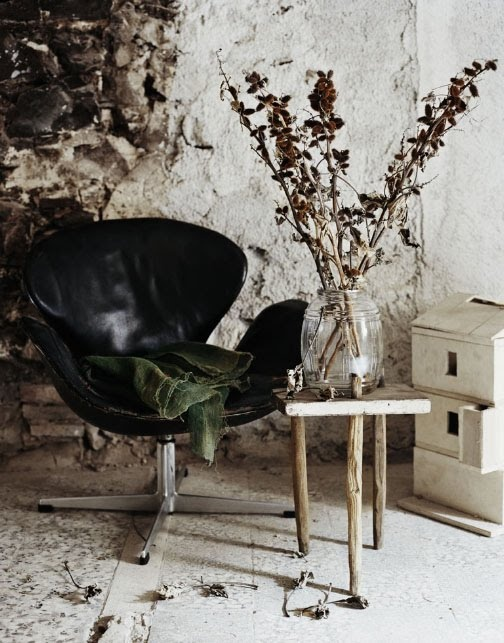 Contemporary chair in rustic interior