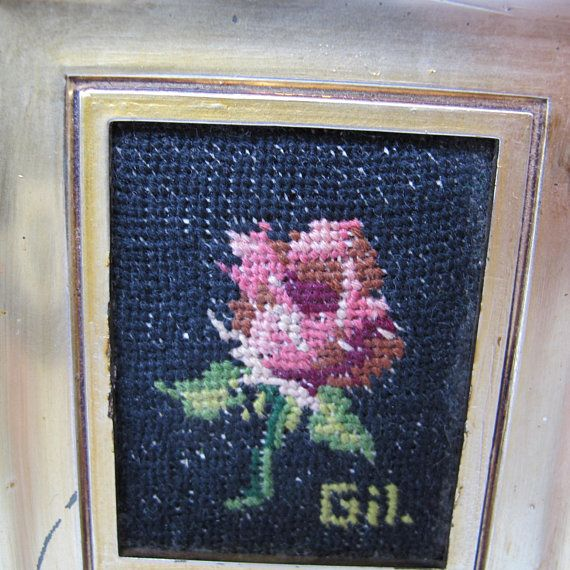 Pair of pretty rose needlepoint pictures. Includes a yellow rose with bud and pink rose, as shown in photos. Both are signed Gil. and framed with gold plastic frames. Include original Made in Italy stickers on the back. Frames are brighter gold than appears in the photos. Note that one