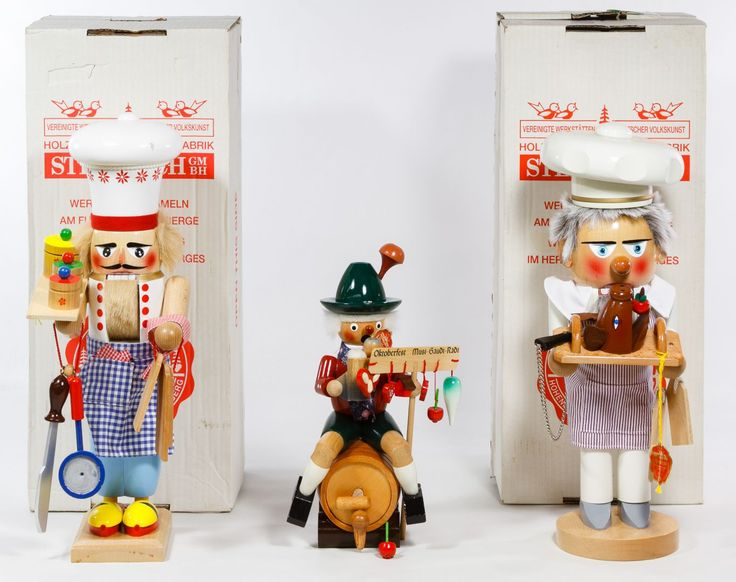 "Lot 358: German Steinbach Wooden Nutcrackers; (3) items including a chef bearing a boar's head, a baker and an ""Oktoberfest"" figure seated on a beer keg with music box and Lowenbrau beer stein; including two boxes"