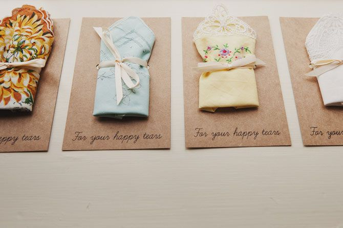 Lovely handkerchiefs/favours laid out on the ceremony chairs