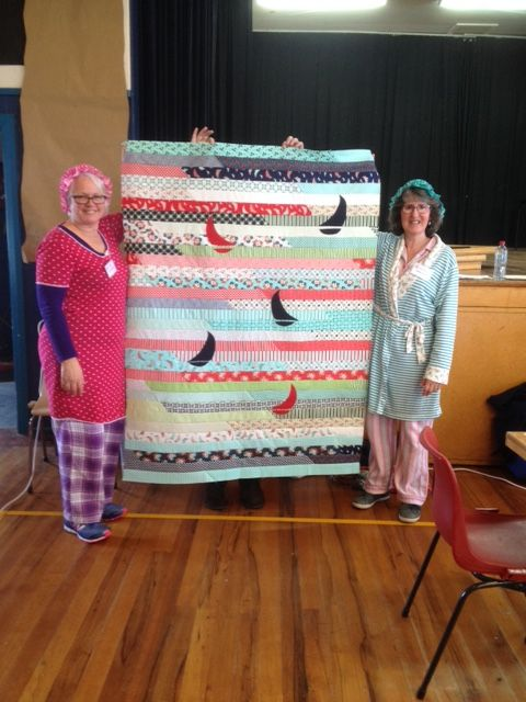 CHARITY Jelly Roll Race quilt. This was made with a Jelly Roll from Bonnie and Camille called Day Sail. Made by my wee quilt group called PJ Quilters - because we enjoy quilting in our comfy pj's. Hence why we are wearing pj's in this photo. PJ Quilters are made up of Lesley, Glennis and Me. (Absent is Sylvia). Fun way to make a charity quilt.
