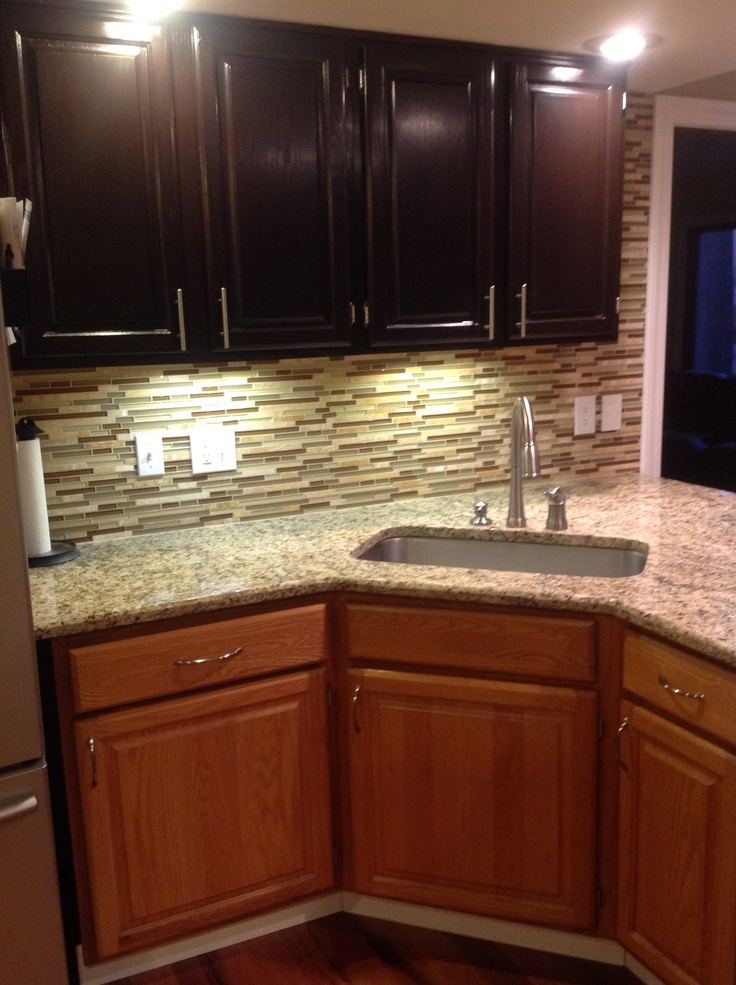 """Gel staining my kitchen. The bottom is the old golden oak and the top is the new java stain. Looks a 1000 times better and updates the kitchen with very little money."" General Finishes Java Gel"