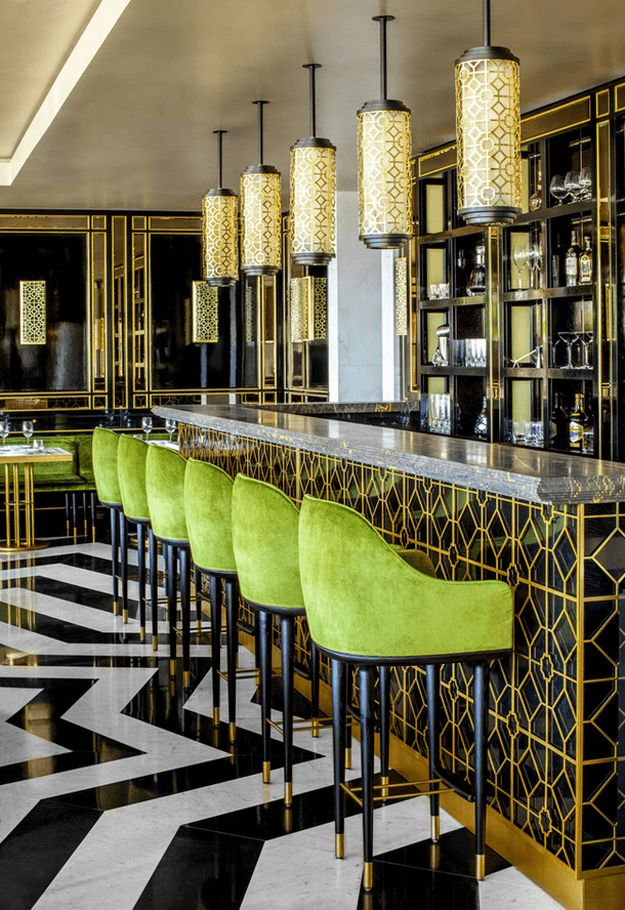 black white and gold restaurant with bright green upholstered stools, pantone greenery, bright green, lime green, spring green, apple green