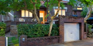 Traditional double-fronted facade with verandah, garage, private parkside home