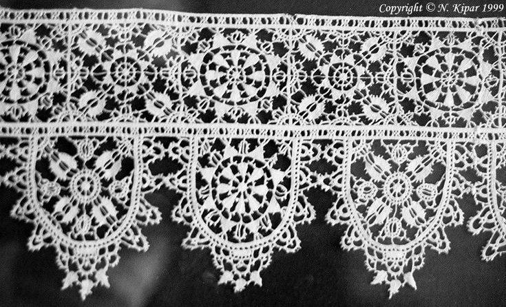 """""""Reticella developed from open-work embroidery by discarding the woven linen and replacing it with needlewoven strands, laid over a pattern, Reticella took the step from embroidery to lace. The designs, executed with closely worked buttonhole stitches, remained mainly geometrical."""" This example, now in the V & A in London, is late 16th century."""