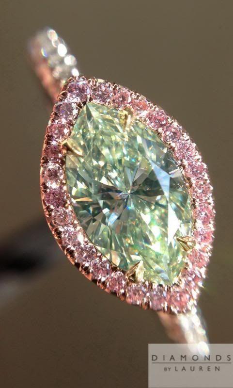 cushion cut diamond in halo setting w/pink diamonds.