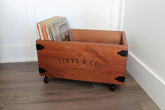 Store your vinyl record collection in style! This rustic inspired crate is the perfect addition for any vinyl collector. These crates hold approximately 80 LP records. The included castors allow for easier mobility and height. Handles on each end of the create allow for easier