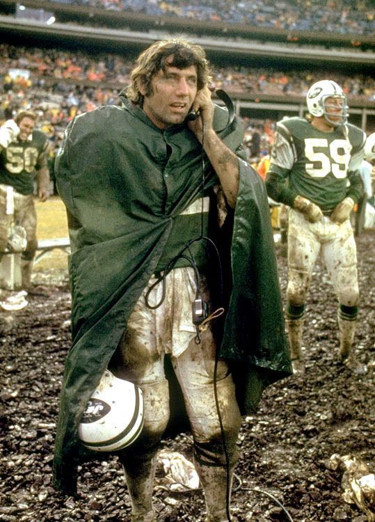<p>New York Jets quarterback Joe Namath listens on the sidelines during a messy New York Jets-Buffalo Bills Game. The Jets would win 20-10 behind Namath's 131 yards and two passing touchdowns.</p>