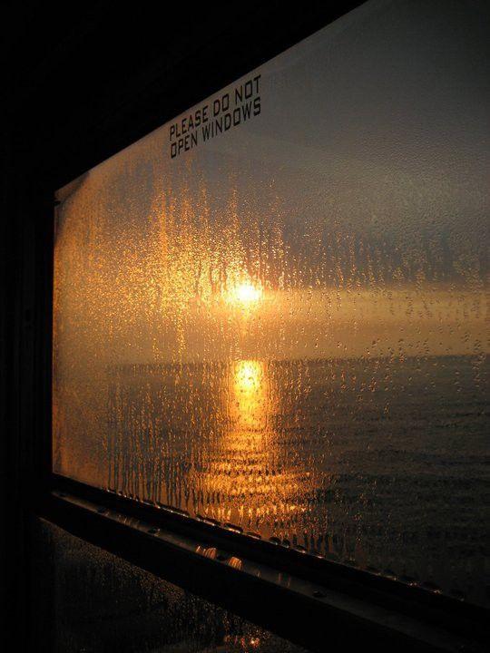 Window +rain + sunset + water = beauty