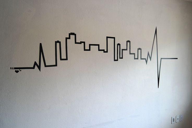 Adesivo de parede com fita isolante