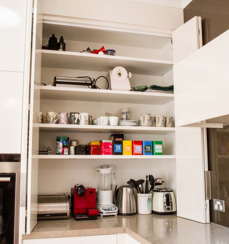 Appliance pantry. Bi-fold doors. www.thekitchendesigncentre.com.au