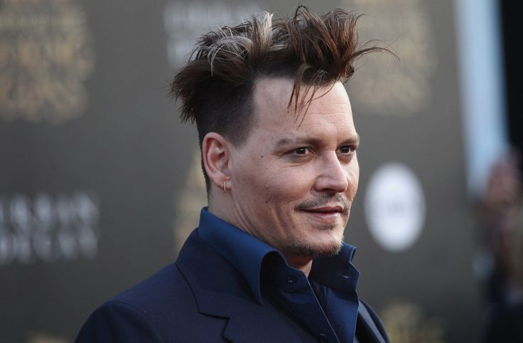 The 'Alice Through the Looking Glass' star debuted his bold new 'do at the film's Los Angeles premiere on Monday