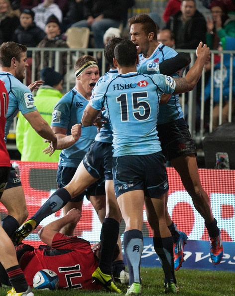 Peter Betham of the Waratahs jumps in the air after scoring a try during the round 16 Super Rugby match between the Crusaders and the Waratahs at AMI Stadium on May 31, 2013 in Christchurch, New Zealand.