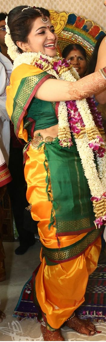 South Indian bride. Temple jewelry. Jhumkis.Mustard and green silk kanchipuram sari.Braid with fresh jasmine flowers. Tamil Brahmin bride. Madisar.Telugu bride. Kannada bride. Hindu bride.Malayalee bride.Kerala bride.South Indian wedding.Dhivyadarshini wedding.