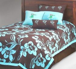 Chocolate brown and aqua blue tropical Hawaiian theme bedding set with hula girls dancing across the pillow shams and hibiscus flowers on the comforter