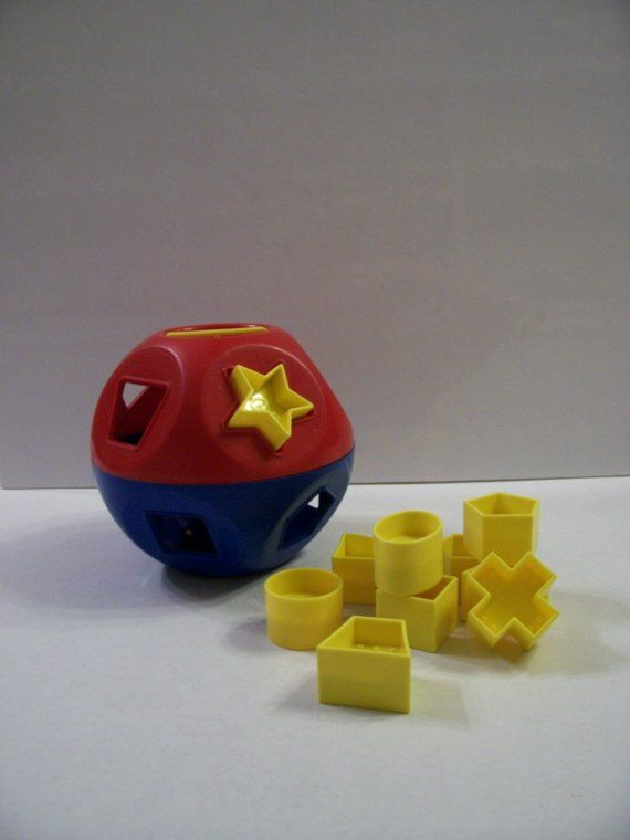 vintage tupperware Shape O Ball - I played with one of these and loved it and had one for my kids also but they didn't play with it much b/c they cant open it to get the shapes out!