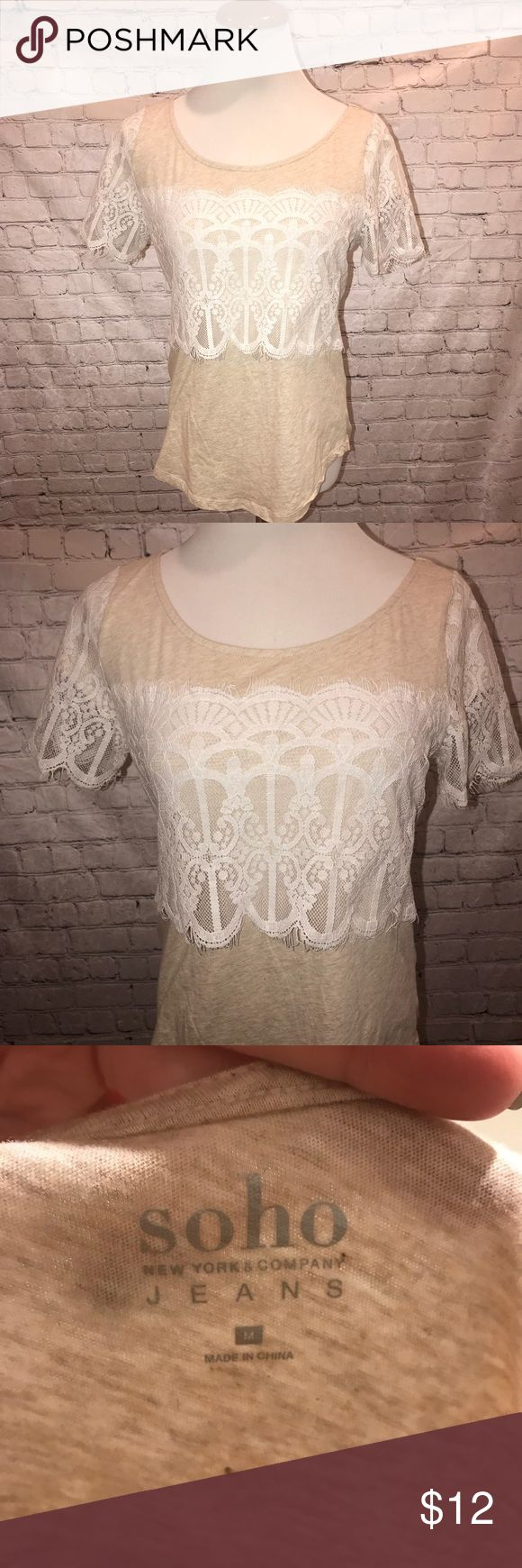 New York and company top NWOT beige short sleeve top. Lace accents on front n sleeve. Size medium but would fit lg also. New York & Company Tops Blouses