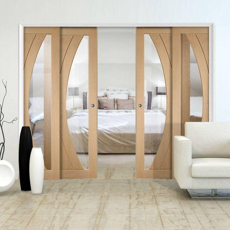 Quad Telescopic Pocket Salerno Oak Veneer Door - Clear Glass.    #glazeddoors #oakdoors #telescopicdoors #pocketdoors #hiddendoors #quaddoors #quadtelescopicdoors #interiordesign #doorideas #newdoors #newflat #newinterior #desingerdoors