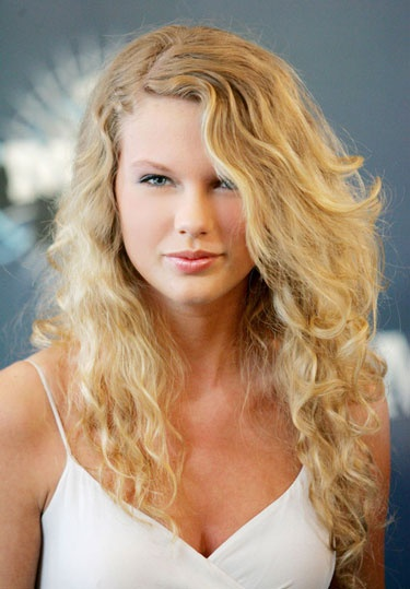 Taylor Swift's Beauty Transformation - 2006: Swift sports a beachy 'do and natural makeup for the CMT Music Awards.