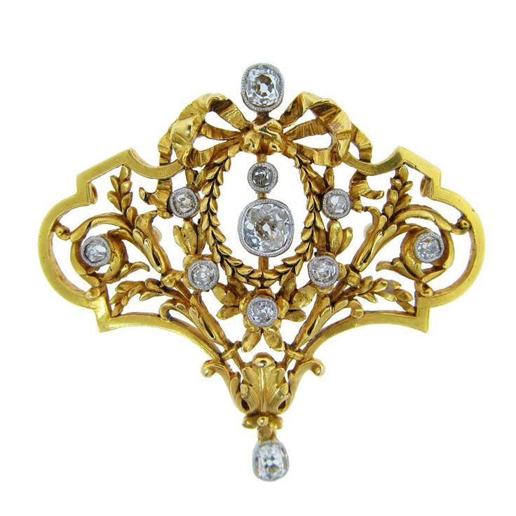 18kt. yellow gold French Edwardian period brooch with removable pin back so the brooch may be worn as a pendant (there are two loops on the back ). The center articulated old cushion cut center weighs approx. .60cts. the 10 additional old cut diamonds total .65cts. circa 1900 hallmarked.