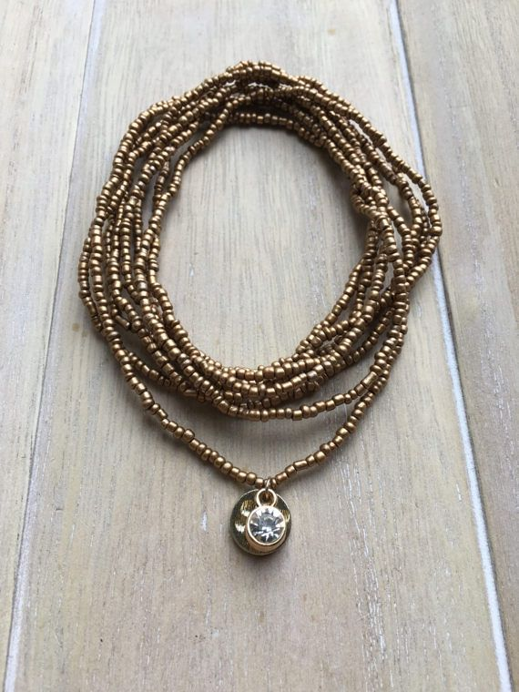 Long wrap necklace, bracelet, gold colored seedbeads with charms