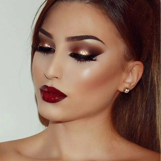 Warm brown, golden eye, heavy contour & dark, red lip. Perfect, glam, makeup look for Christmas.