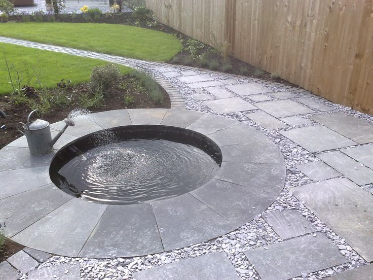 A small round pond a sprinkler equal a stunning water for Garden pond design and construction