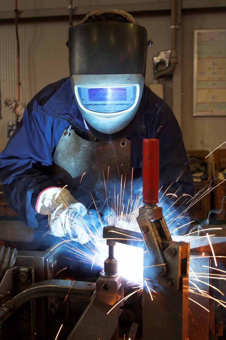 The mask for his welding machine