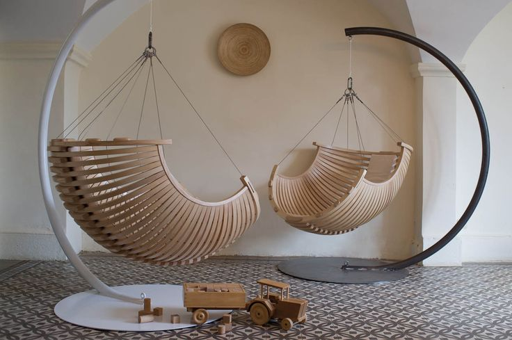 Unique cool curved wood hanging chair design inspiration for awesome outdoor and indoor home interior design. #IndoorFurniture #OutdoorFurniture #HangingChair #Netnoot www.netnoot.com