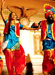 Bhangra- A well known traditional indian dance most often preformed at wedding by men (for women its the Gidha). It consists of all the guests raising their hands up and making a twisting motion with their hands and feet to the music.