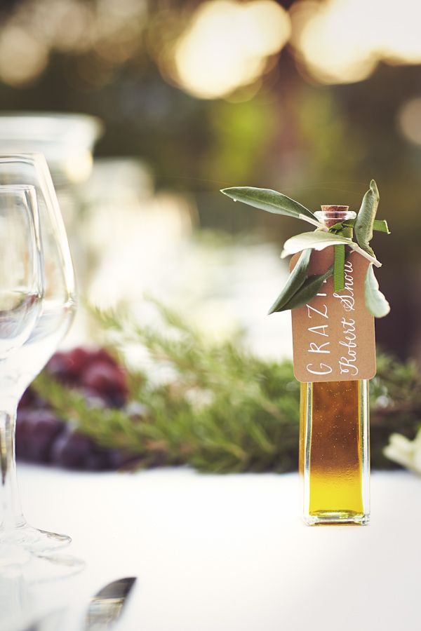 This wedding had olive oil double as seating cards and favors to go with the menus at each place setting. Photo by: Italian Wedding Photography By Jules